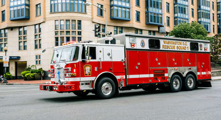 Washington June 2017 US: Emergency truck across the streets of Washington downtown, Rescue Squad 1 with bright shining signs and advertisements are visible on the front of the fire truck. Editorial