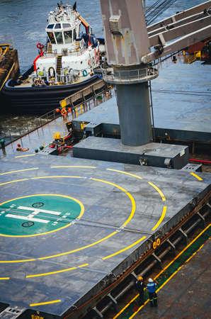 Tugboat and ship with helipad area
