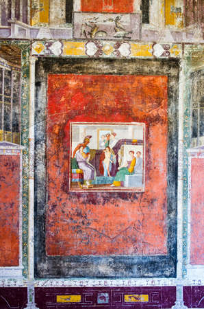 Wall of a tablinum with fresco of Venus and Mars in a house of ancient Pompeii buried by the volcanic eruption of Vesuvius in 79 AD