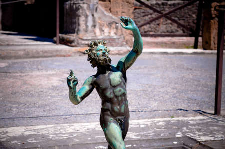 Pompeii ruins, the impluvium of the bronze statue of the faun or dancing satire. Pompeii is an ancient Roman town destroyed by vesuvius eruption in 79 BC