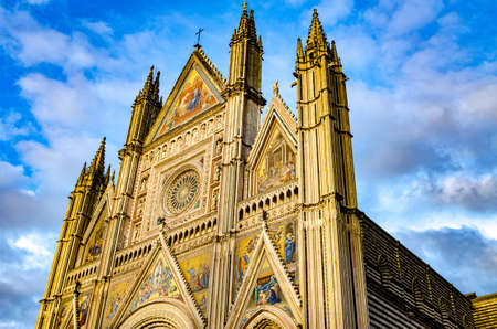 Facade of the Cathedral of Santa Maria Assunta, Duomo of Orvieto in Italian Gothic style.
