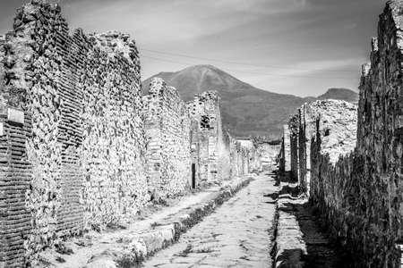 Street of Pompeii excavations after Vesuvius eruption in black and white