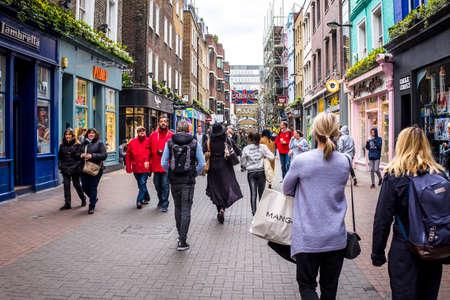 shopping in Carnaby Street , london