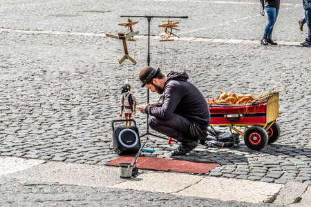 Naples 2017 March 19, Italy: puppets at Piazza del Plebiscito in Naples, and puppeteers prepares his show for the children in the square, on a sunny spring day. Editorial