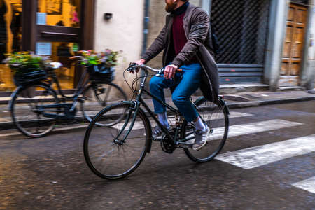 Bicycle road with cyclist in Florence , Italy