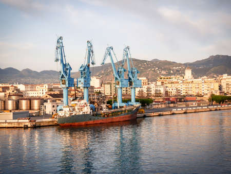 cargo ship moored at the quay of the port of Palermo on a sunny spring morning Standard-Bild