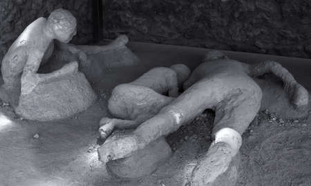 A plaster cast of victims in last moments of the eruption of the volcano Vesuvius 79 BC. Pompeii, Italy