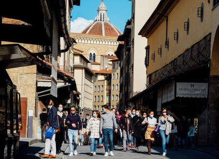 Tourists in times of Covid-19 Ponte Vecchio historic bridge in Florence, Italy