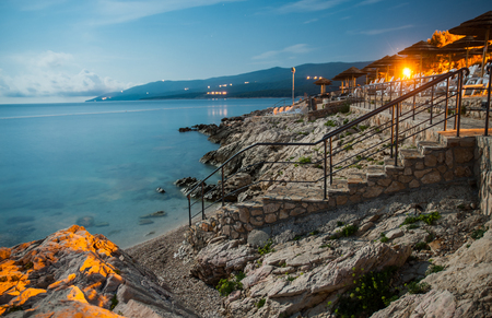 Rabac beach at night with full moon, Croatia photo