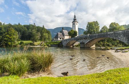bohinj: Bohinj lake with church and bridge, Slovenia