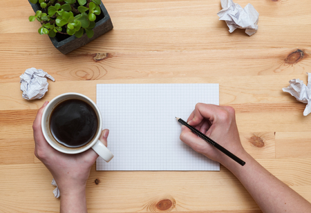 wadded: Blank notepad with pencil and coffee on wooden desk