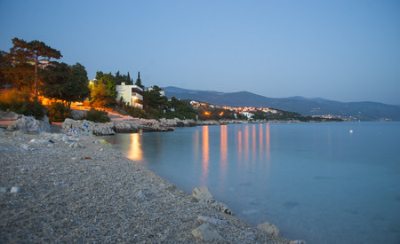 Sunset on Novi Vinodolski beach, Croatia. Long exposure photography.