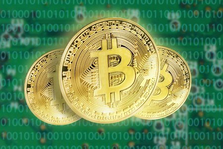 Bitcoins concept with electrical circuit in the back Stock Photo - 93970383