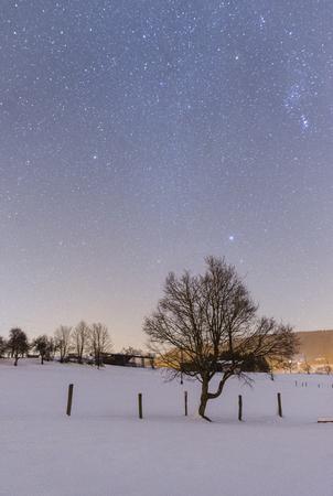 Night snowy scene in Tuhinj valley, Slovenia Standard-Bild