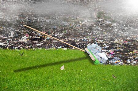Broom sweeping away the garbage, ecology concept Standard-Bild