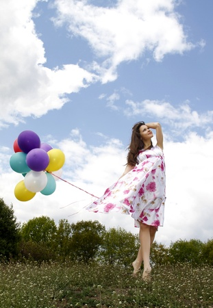 woman with baloons photo