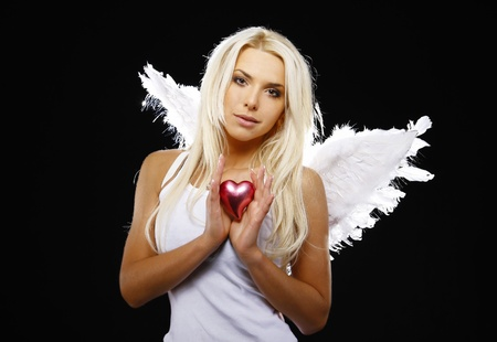 beautiful angel holding a heart  photo