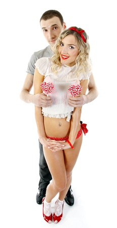 intimacy: young happy couple with candies in the shape of hearts  Stock Photo