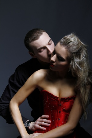 passion couple: man kissing woman in her neck