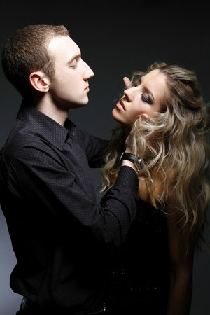 handsome man is about to kiss a beautiful woman  photo