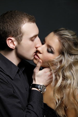 handsome man kissing a beautiful woman  photo