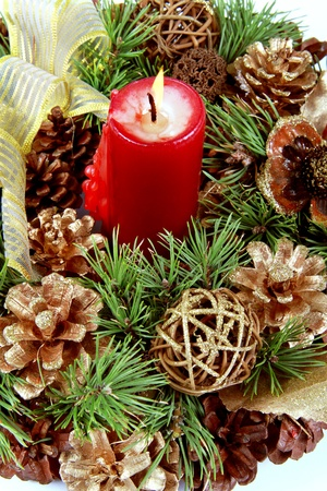 candle in the Christmas fir cone photo