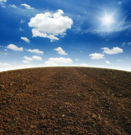 Soil Background mud puddle marsh well blue sky rice Stock Photo
