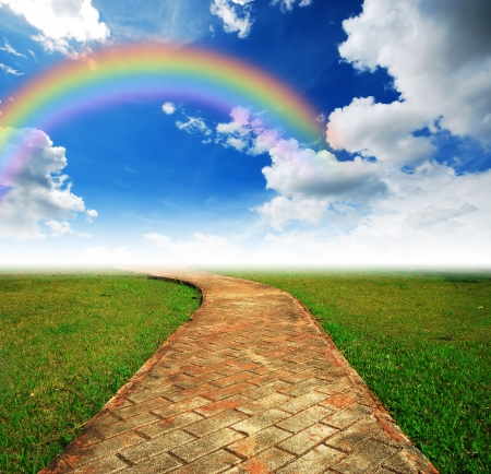rainbow scene: Alone way green grass cloudy blue sky to destination and green way to the future rainbow