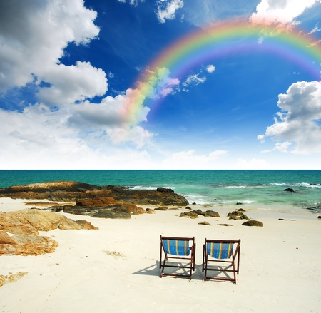 sea sand sun beach together blue sky chair alone background design stone clear rainbow Stock Photo