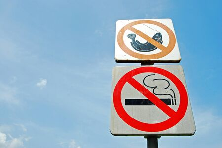 Signs no smoking and no fishing photo