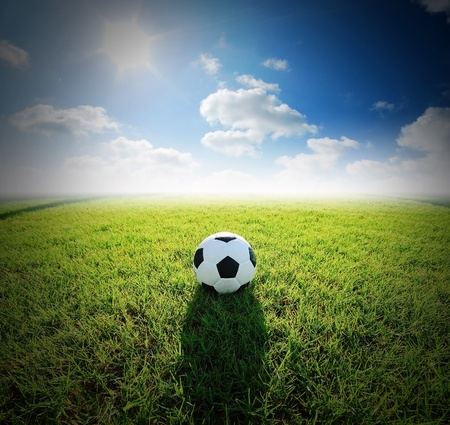 football field soccer stadium on the green grass blue sky sport game background for design
