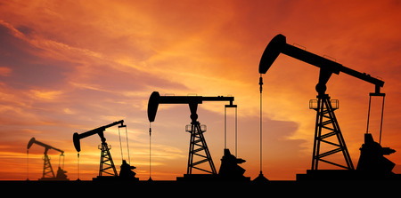 jack pump: Oil pump oil rig energy industrial machine for petroleum in the sunset background for design