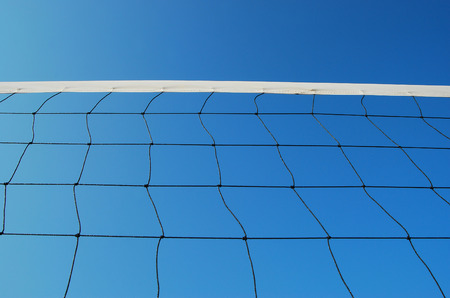 Volleyball net on the beach blue sky for background design  photo