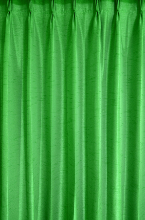 patched: Green curtain texture background with space for design
