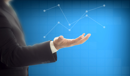 Businessman holding graph digital graphic on hand , business concept