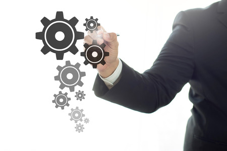 hand pen: Businessman drawing gears , business concept Stock Photo