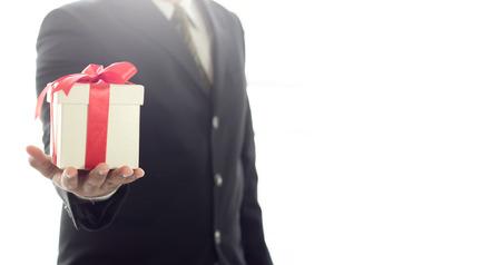 Businessman with Gift box for bonus Stock Photo