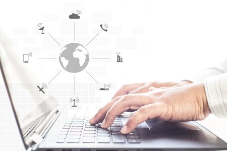 Businessman hands using laptop and mobile phone with social network diagram , communication network concept