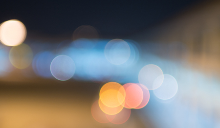 Circle light bokeh background at night time with space for design