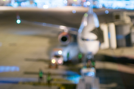 Aircraft at gate in airport terminal blurred defocus background