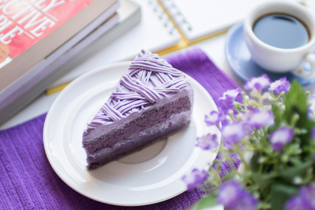 Purple taro cake with coffee at coffee cafe take a break time