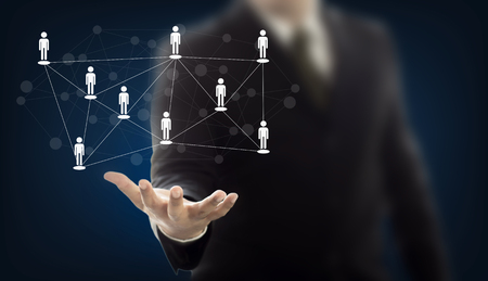 Businessman hand holding virtual icon of network and communication of people