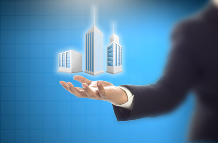 Business engineer hand holding of construction building Imagens