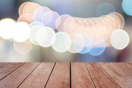 Wooden way with bokeh circle light background for background design