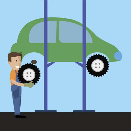 workshop employee change a tire on the car