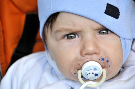 Serious looking baby with dummy Stock Photo - 15143201