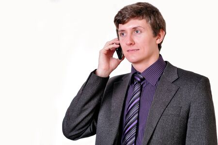 Young businessman in violet tie speaks by phone photo