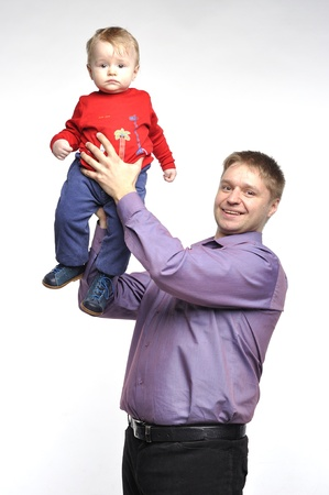 Father in violet shirt holds little boy photo