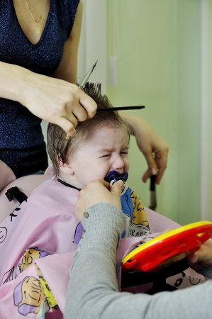 Hairstyle of the one-year-old child first time photo