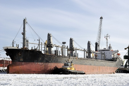 frost bound: Cargo ship moored to port in the winter time